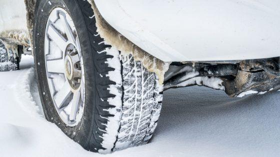 67340720 - closeup of 4x4 suv car wheels driving on snow